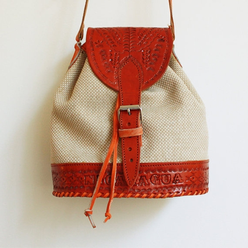 Vintage woven and leather drawstring bucket bag by CaesarPony
