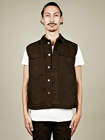 A Sauvage Sleeveless Denim Jacket in dark forest green at oki ni