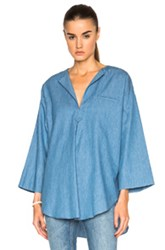 Nomia Oversized Tunic Top In Blue