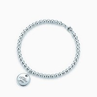 Tiffany And Co. Notes I Love You Disc Charm In Sterling Silver On A Bead Bracelet. No Gemstone