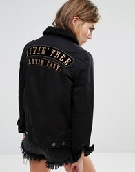 Lira Oversized Boyfriend Denim Jacket With Back Slogan Black