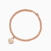 Tiffany And Co. Return To Tiffanytm Mini Heart Tag In 18K Rose Gold On A Bead Bracelet Small.