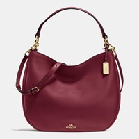 Coach Nomad Hobo In Glovetanned Leather Light Gold Burgundy