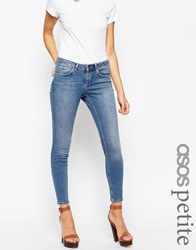 Asos Petite Whitby Low Rise Skinny Jeans In Tasmin Mid Blue Wash With Abrasion Pocket Detail Midstonewash