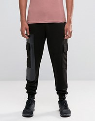 Asos Tapered Joggers With Cargo Pockets And Printed Panels Black