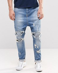 Asos Drop Crotch Jeans With Extreme Rips In Mid Blue Mid Blue