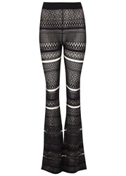 Mcq By Alexander Mcqueen Black Flared Geometric Knit Trousers