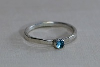 Sterling Silver Hammered Stack Ring With Blue Topaz By Nicilaskin