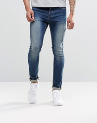 Asos Super Skinny Jeans In 12.05Oz Tinted Blue Mid Blue