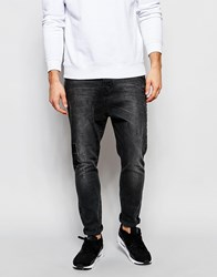 Asos Drop Crotch Jeans With Rip And Repair In Washed Black Washedblack