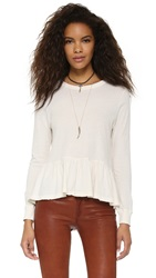 The Great. The Long Sleeve Ruffle Tee Washed White