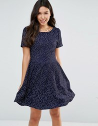 Yumi Short Sleeve Tie Back Dress In Polka Dot Navy