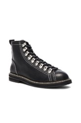 Givenchy Lace Up Leather Boots In Black