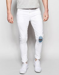 Asos Super Skinny Jeans With Knee Rips And Patch Detail White