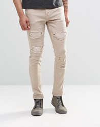 Asos Skinny Jeans With Extreme Rips In Stone Light Pink