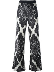 Hache Floral Print Flared Trousers Black