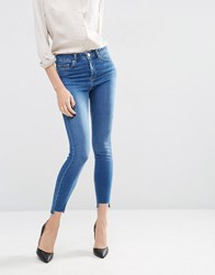 Asos Ridley Skinny Jeans In Akira Bright Wash With Stepped Hem Blue