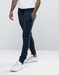 Religion Jersey Joggers In Slim Fit With Metal Badge And Zip Cuff Navy