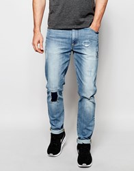 Asos Skinny Jeans In Light Wash With Rip And Repair Patches Blue