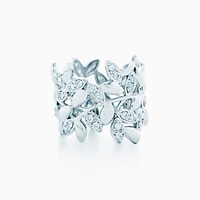 Tiffany And Co. Paloma Picasso Olive Leaf Band Ring In 18K White Gold With Diamonds.