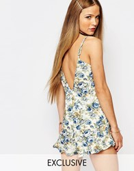 Reclaimed Vintage Frill Hem Romper With Low Back In Floral Print Multi