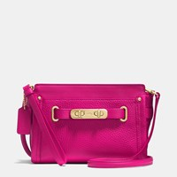 Coach Swagger Wristlet In Pebble Leather Light Gold Cerise