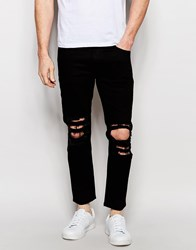 Asos Skinny Jeans In Cropped Length With Extreme Rips Black
