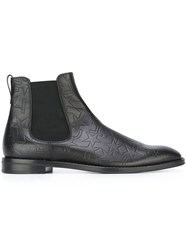Givenchy Logo Embossed Chelsea Boots Black