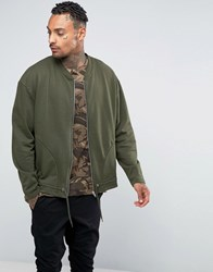 Asos Oversized Jersey Bomber Jacket With Drawstring Hem In Khaki Field Green