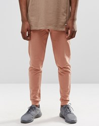 Asos Skinny Joggers In Light Stone Cork Pink