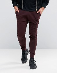 Asos Super Skinny Joggers In Burgundy Oxblood Red
