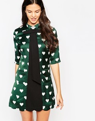 Yumi Pussybow Tunic Top In Heart Print Green