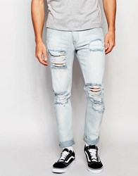 Asos Skinny Jeans With Extreme Rips In Bleached Wash Light Blue