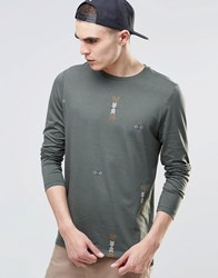 Asos Longline Long Sleeve T Shirt With All Over Aztec Print And Step Hem Green Black