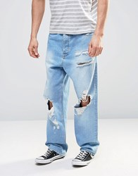 Asos Oversized Jeans With Mega Rips In Light Blue Bleach Blue