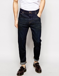 Asos Stretch Tapered Jeans In Coated Dark Wash Indigo