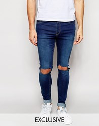 Reclaimed Vintage Washed Super Skinny Jeans With Knee Rips Blue
