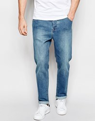 Asos Stretch Tapered Jeans In Green Caste Mid Blue Blue