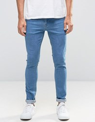 Asos Super Skinny Jeans In Retro Mid Wash Blue Mid Blue