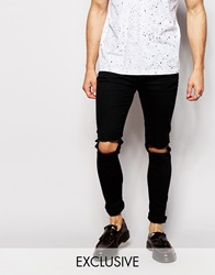 Reclaimed Vintage Super Skinny Jeans With Knee Rips Black