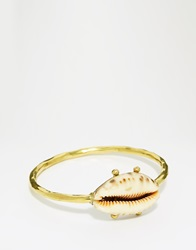 Mirabelle Hammered Brass Bangle With Cowrie Shell
