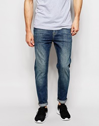 Asos Stretch Tapered Jeans In Vintage Dark Wash Midblue
