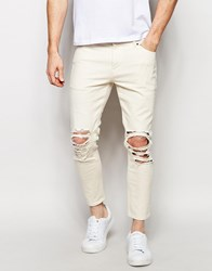Asos Skinny Jeans In Cropped Length With Extreme Rips Ecru