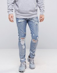 Asos Super Skinny Jeans With Mega Rips In Metalic Sliver Coated Blue Metalic Blue