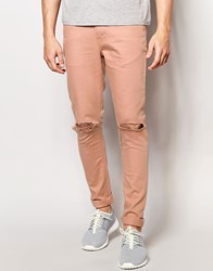 Asos Super Skinny Jeans With Knee Rips In Pink Mahogany Rose