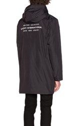 Stussy Insulated Long Hooded Coach Jacket In Black