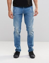 Asos Stretch Slim Jeans With Abrasions In Light Wash Blue Light Blue