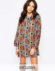 Reclaimed Vintage Long Sleeve Tunic Dress With Tie Back Detail In Aztec Print Multi