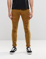 Asos Super Skinny Jeans With Extreme Rips In Brown Rubber Brown