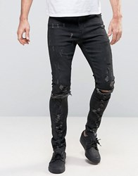 Asos Super Skinny Jeans With Abrasions And Knee Zip Rips In Black Coating Black